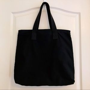 Guess Bags   Black Canvas Tote Bag   Poshmark 9d7d81dfdd